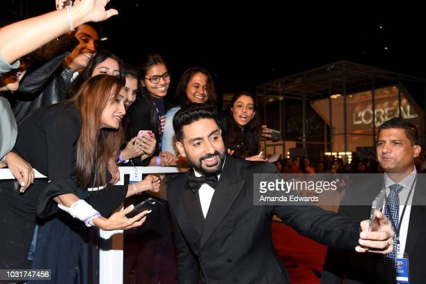 Abhishek Bachchan takes selfies with fans at the 'Husband Material' premiere during 2018 Toronto International Film Festival at Roy Thomson Hall on...