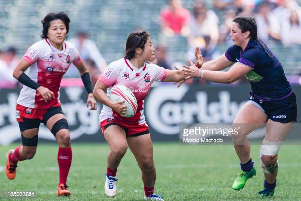 Abi Evans of Scotland tries to put a tackle on Yume Okuroda of Japan on day one of the Cathay Pacific/HSBC Hong Kong Sevens Semi-Final match between...