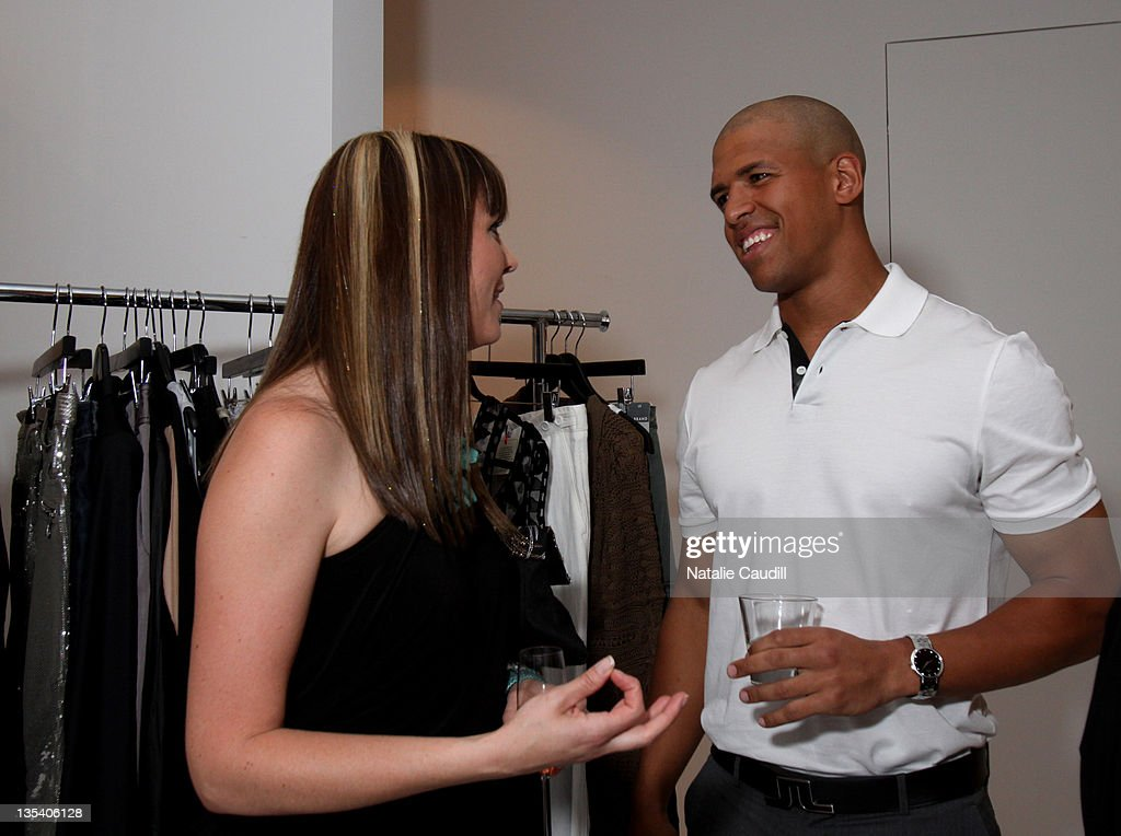 Abi Ferrin and Dallas Cowboy Miles Austin attend the Vogue and Net-A-Porter.com Spring-Summer 2010 collection preview event at Dallas W Residences on April 22, 2010 in Dallas, Texas.