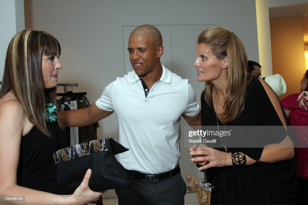 Abi Ferrin, Dallas Cowboy Miles Austin and Vogue's Anne Vincent attend the Vogue and Net-A-Porter Spring-Summer 2010 collection preview event at Dallas W Residences on April 22, 2010 in Dallas, Texas.
