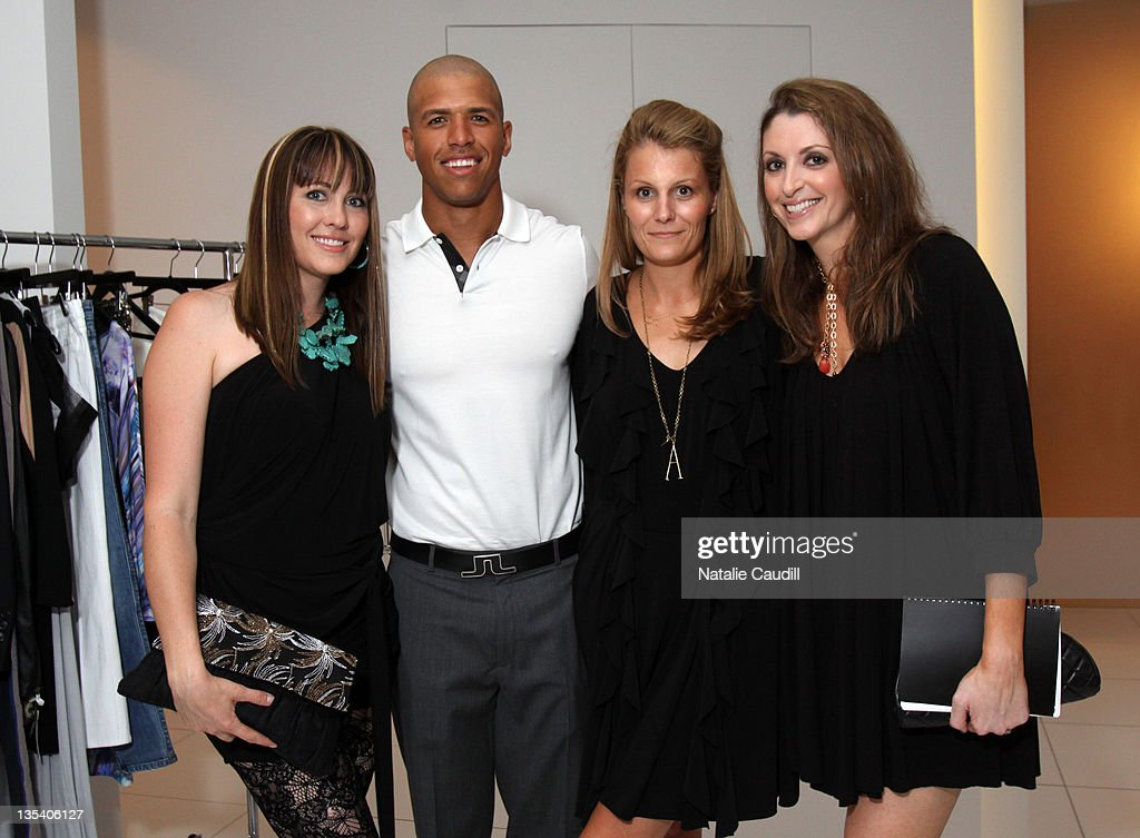 Abi Ferrin, Dallas Cowboy Miles Austin, Vogue's Anne Vincent and Victoria Snee attend the Vogue and Net-A-Porter.com Spring-Summer 2010 collection preview event at Dallas W Residences on April 22, 2010 in Dallas, Texas.