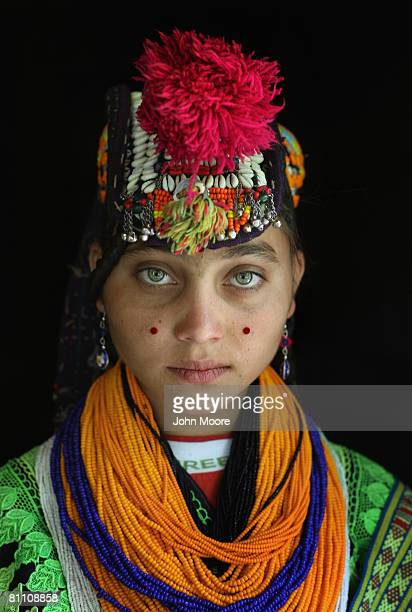 Abi Gul age 15 grand daughter of Bibi Kai of the polytheistic Kalash tribe stands in the doorway of her extended family home May 15 2008 in the...