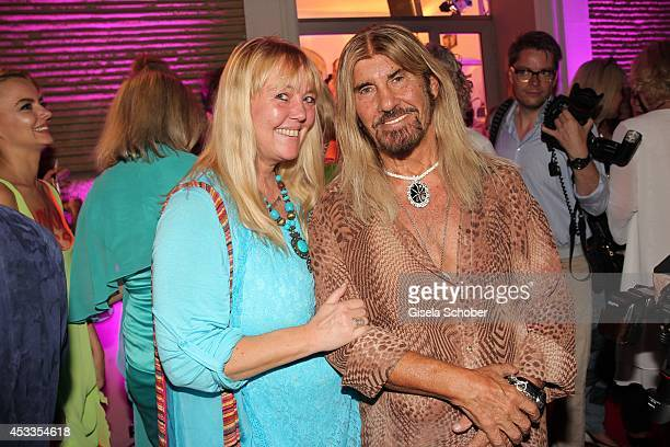Abi Ofarim and his girlfriend Kirsten Schmidt attend the Susanne Wiebe fashion show 'Upgrade Your Self' on August 8 2014 in Munich Germany