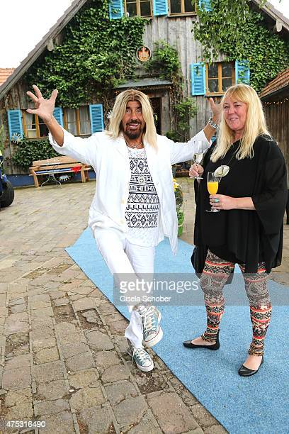 Abi Ofarim and his girlfriend Kirsten Schmidt during the Mauro Bergonzoli Country Life Studio Opening on May 30 2015 in Kirchheim Germany