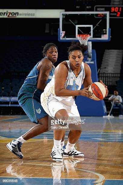 Abi Olajuwon of the Chicago Sky drives past Nicky Anosike of the Minnesota Lynx during the preseason WNBA game on May 6 2010 at the AllState Arena in...