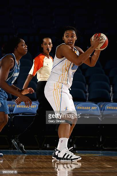 Abi Olajuwon of the Chicago Sky looks to pass over Nicky Anosike of the Minnesota Lynx during the preseason WNBA game on May 6 2010 at the AllState...