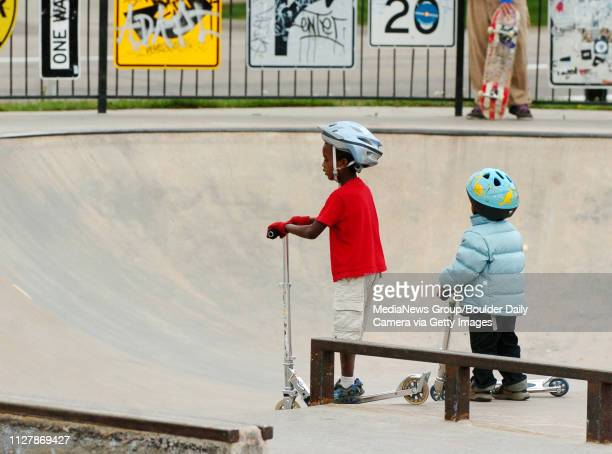Abi Sjong left and his brother Zuru wait for the big kids before riding the bowls at Scott Carpenter Park on Thursday