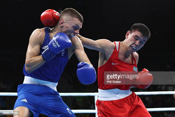 Abialkhan Zhussupov of Kazikstan fights Pat McCormack of Great Britain in their Mens Light Welterweight bout on Day 6 of the 2016 Rio Olympics at...