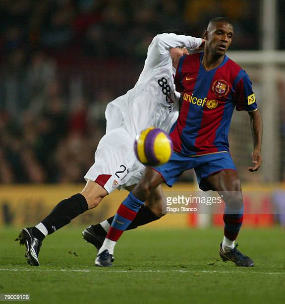 Abidal of Barcelona and Alfaro of Sevilla in action during the Copa del Rey match between FC Barcelona and Sevilla played at the Camp Nou stadium on...