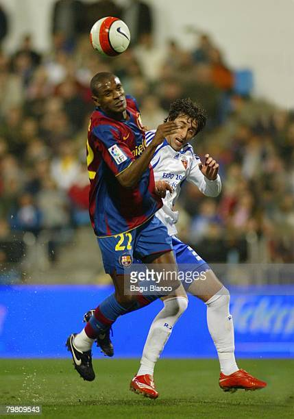 Abidal of Barcelona and Diego Milito of Zaragoza in action during the La Liga match between Real Zaragoza and FC Barcelona at the La Romareda stadium...