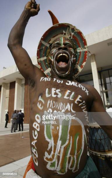 A supporter of the Ivory Coast football team is pictured outside the presidential palace in Abidjan 10 October 2005 during a ceremony with Ivory...