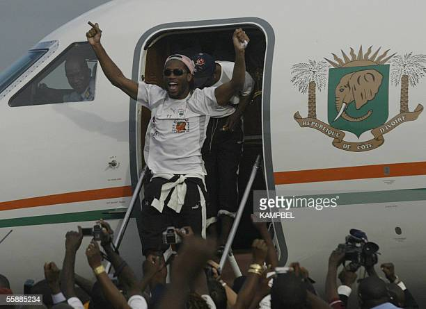 Drogba Didier jubilates at the door of the presidential plane at Felix Houphouet Boigny airport 09 October 2005, arriving with the victorious Ivorian...