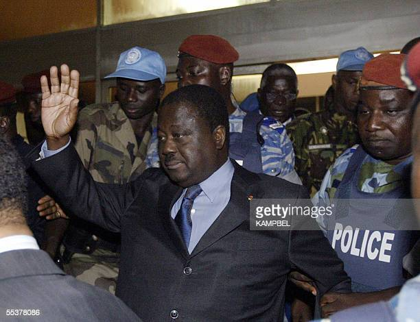 Former Ivory Coast president Henri Konan Bedie greets supporters upon arrival 11 September 2005 at the aeroport of Felix Houphouet Boignie a Abidjan...
