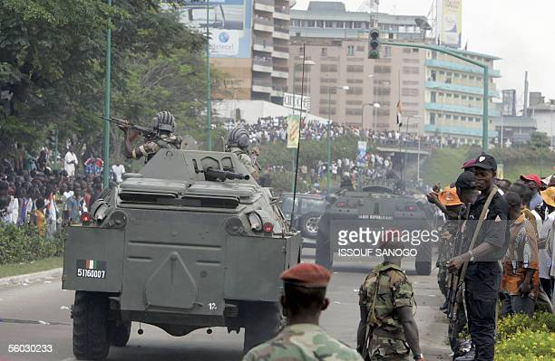 Ivorian soldiers on APC's parade in the Plateau business district of Abidjan 29 October 2005 during military maneuvers Last week the UN Security...