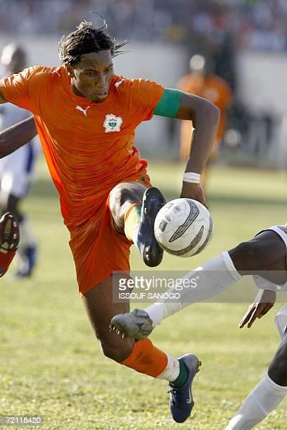 Ivory Coast Elephants striker Didier Drogba vies with Gabonese defenders 08 October 2006 during their African Nations Cup qualifier in Abidjan Ivory...