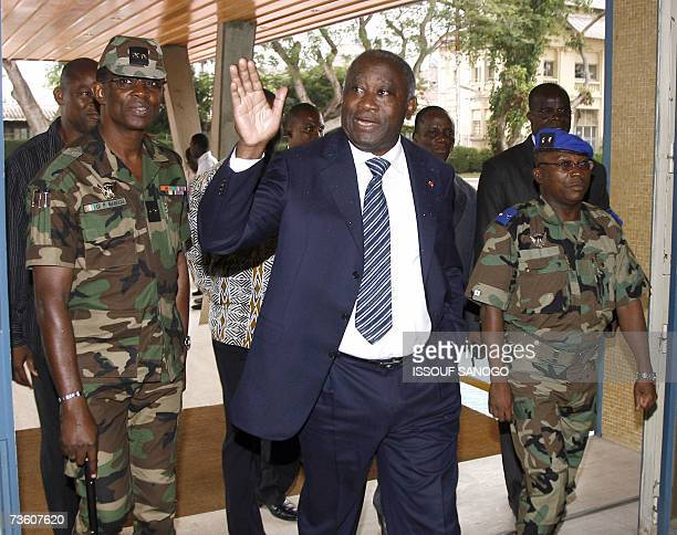 Ivory Coast's President Laurent Gbagbo greets the press 16 March 2007 at the Presidential palace in Abidjan surrounded by army Chiefs of Staff...