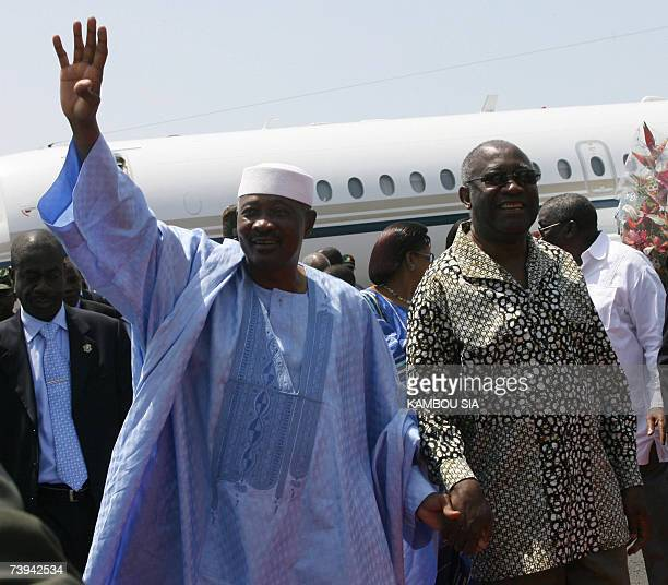 Malian President Amadou Toumani Toure is welcomed by Ivory Coast president Laurent Gbagbo 21 April 2007 at the Felix Houphouet Boigny airport in...
