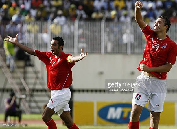 Players of Egypt's alAhly Shady Mohammed and Amr Mohammed Hassan celebrate after winning their their second leg of the African Champions League...