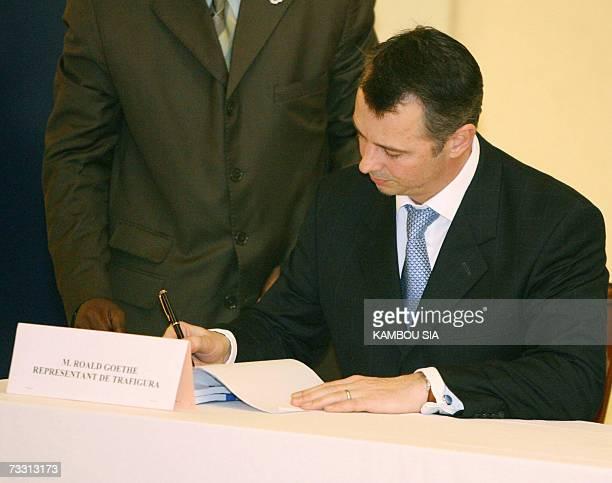 Roald Goethe, spokesman of the Dutch company Trafigura, signs official documents 13 February 2007 in Abidjan. The Dutch company Trafigura agreed to...