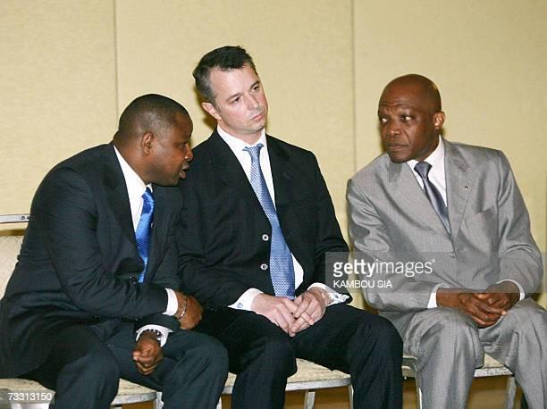 Roald Goethe , spokesman of the Dutch company Trafigura, listen to Camara Adama and Faye Lamine , lawyers of the Trafigura company, 13 February 2007...