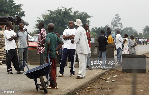 Supporters of Ivorian President Laurent Gbagbo erect barricades to protest against the identification campaign in Abidjan 19 July 2006 Despite...