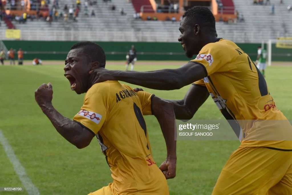 Abidjan players Agbegniadan Komilan (L) and Christian Alex Angbandji (R) celebrate a goal during the African Champions league football match between Asec d'Abidjan and Buffaloes of Benin at the Fel...