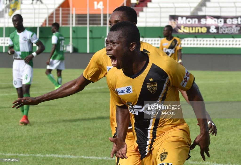 Abidjan players Agbegniadan Komilan (L) and Christian Alex Angbandji (R) celebrate a goal during the African Champions league football match between Asec d'Abidjan and Buffaloes of Benin at the Felix Houphouet-Boigny stadium in Abidjan on February 21, 2018. /
