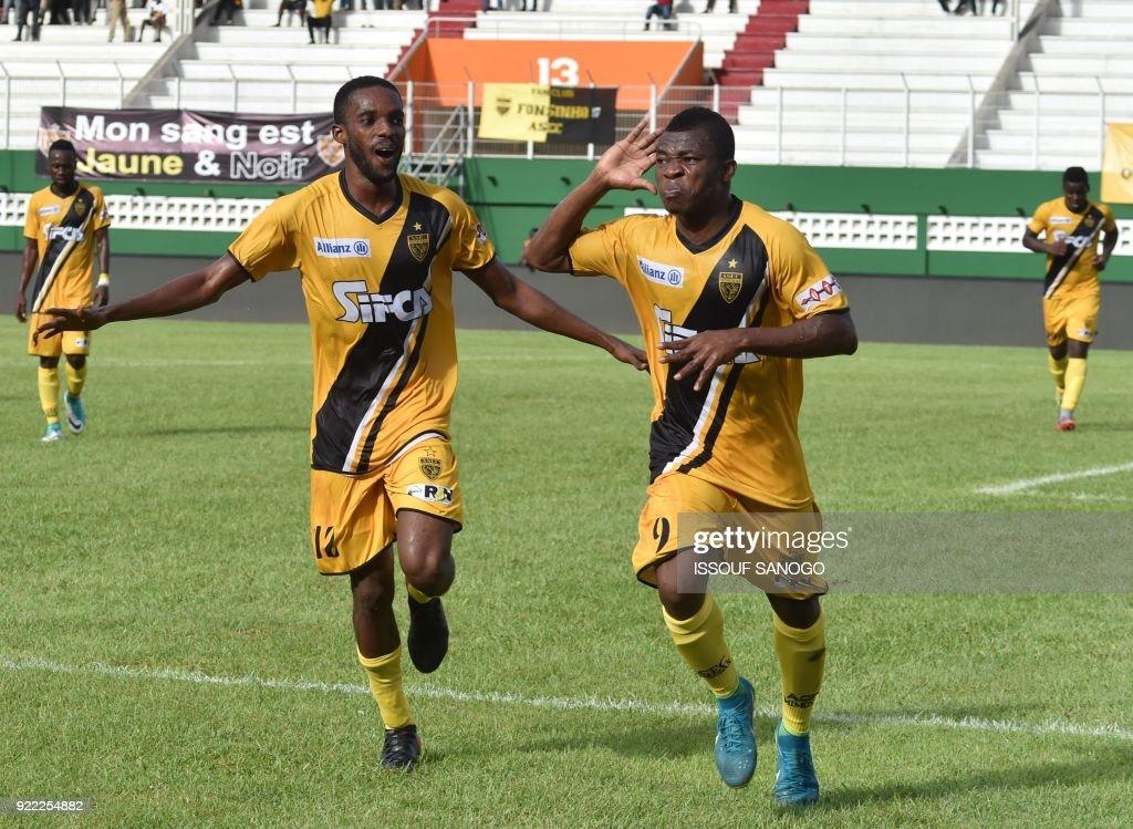 Abidjan players Agbegniadan Komilan (L) and Christian Alex Angbandji (R) celebrate a goal during the African Champions league football match between Asec d'Abidjan and Buffaloes of Benin at the Felix Houphouet-Boigny stadium in Abidjan on February 21, 2018. /