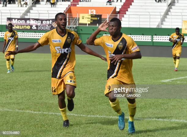 Abidjan players Agbegniadan Komilan and Christian Alex Angbandji celebrate a goal during the African Champions league football match between Asec...