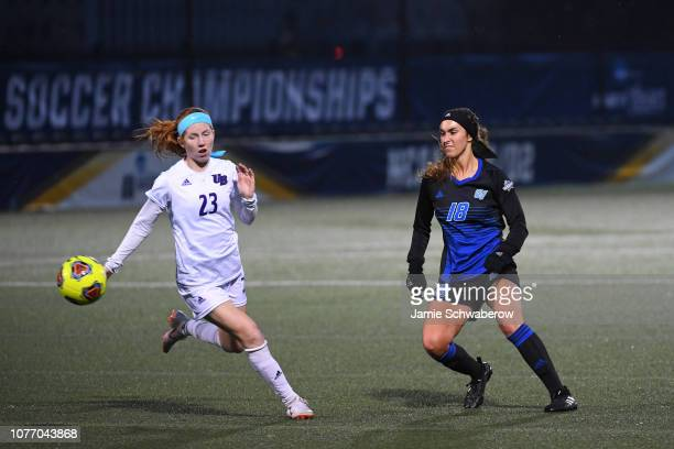 Abigail Befford of the Bridgeport Purple Knights and Corey Sawall of the Grand Valley State Lakers battle for the ball during the Division II Women's...
