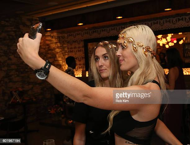 Abigail Breslin and Emily Bach try on jewellery at the New York Fashion Week Brunch with Kali Hawk and Natalie Zfat at Trademark Restaurant on...