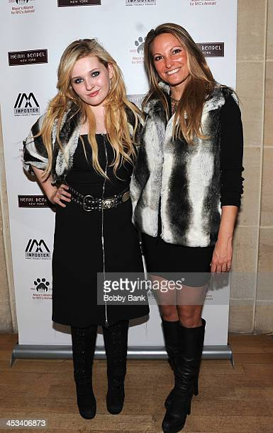 Abigail Breslin and Jaclyn Sharp attends the NYC Loves Animals shopping event hosted by Imposter and Henri Bendel at Henri Bendel Boutique on...
