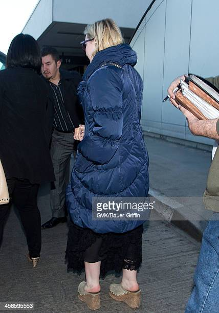 Abigail Breslin is seen at LAX airport on December 14 2013 in Los Angeles California