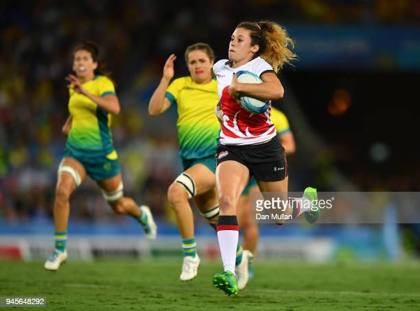 Abigail Brown of England makes a break to score a try during the Rugby Sevens Women's Pool B match between Australia and England on day nine of the...
