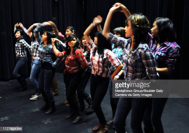 Abigail Casado right front and Marisol Macias join other Kepner Middle School students during a cultural dance at Old Main The University of Colorado...