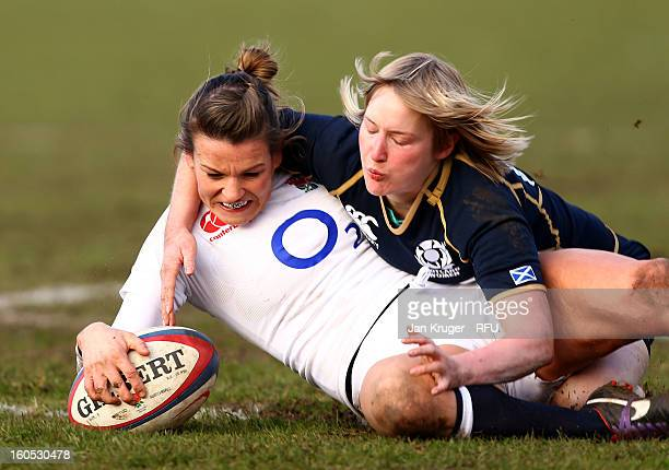 Abigail Chamberlain of England Women scores her second try under pressure from Lauren Harris of Scotland during the Womens Six Nations match between...