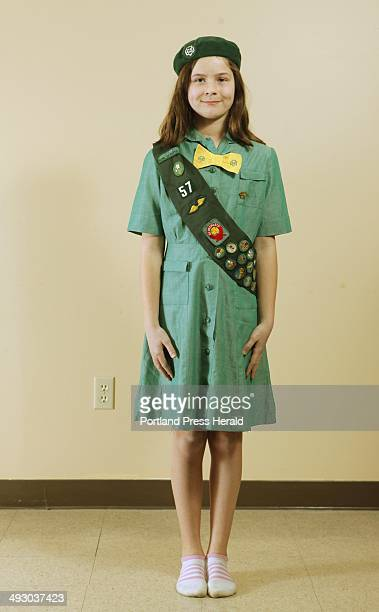 Abigail Cloutier a girl scout with Troop 42 in Cumberland and North Yarmouth models a Girl Scout uniform used from 19601970 Photographed at the...
