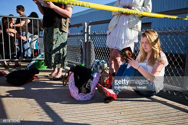 Abigail Day of Cornish reads a book while waiting to audition for American Idol at the Maine State Pier Wednesday July 9 2014 Day who was going to...