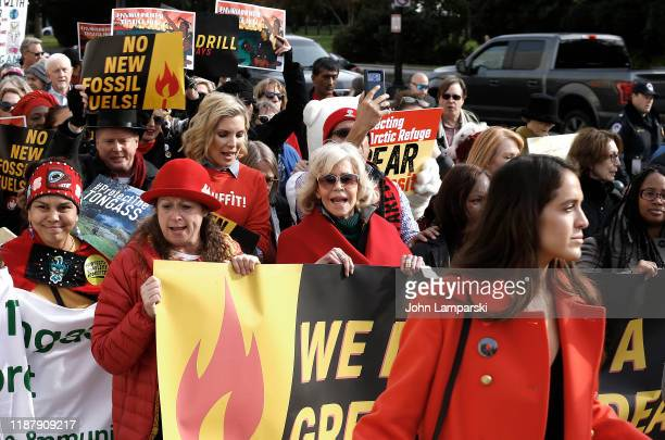 """Abigail Disney, June Diane Raphael and Jane Fonda demonstrate outside the Russell US Senate office building during """"Fire Drill Friday"""" climate change..."""