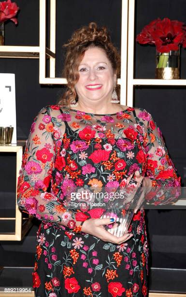 Abigail Disney poses with the Amicus Award at the 33rd Annual IDA Documentary Awards at Paramount Theatre on December 9 2017 in Los Angeles California