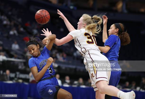 Abigail Groeneweg of Forest Lake is charged with an offensive foul on Hopkins Raena Suggs during girls class 4A quarter final action at Target Center...