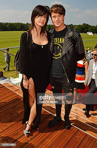 Abigail Johns and Laurie Calvert attend day two of the Audi Polo Challenge at Coworth Park on May 29 2016 in London England
