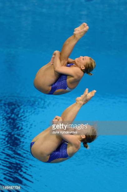 Abigail Johnson and Kelci Bryant of the United States dive during the Women's Synchronized 3m Springboard Final at the 2012 London Olympic Games on...