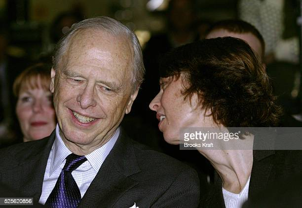 Abigail Johnson president of Fidelity Management Research Co talks to her father Fidelity Chairman Edward C Johnson III as President George W Bush...