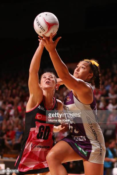 Abigail LatuMeafou of the Firebirds and Fiona Themann of the Tunderbirds compete for the ball during the round six Super Netball match between the...