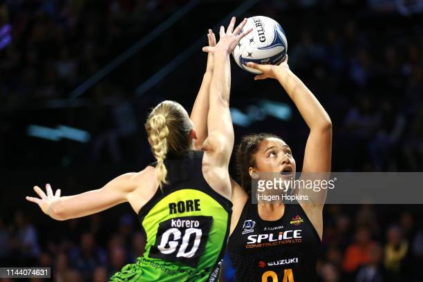 Abigail LatuMeafou of the Magic shoots under pressure from Katrina Rore of the Pulse during the ANZ Premiership netball match between the Central...