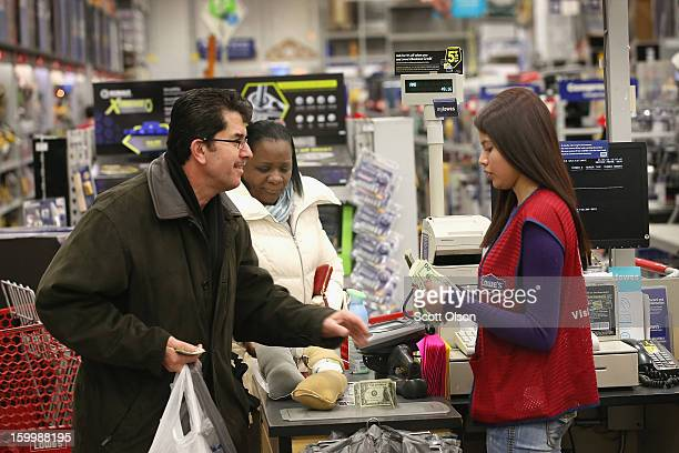 Abigail Marquez rings up a customer's purchase at a Lowe's home improvement store on January 24 2013 in Chicago Illinois Lowe's said they plan to...