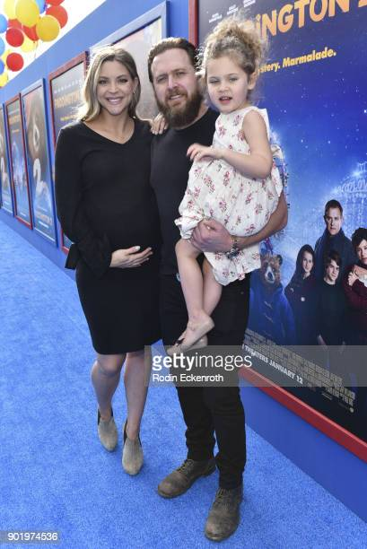 Abigail Ochse actor A J Buckley and Willow Phoenix Buckley arrive at the premiere of Warner Bros Pictures' Paddington 2 at Regency Village Theatre on...