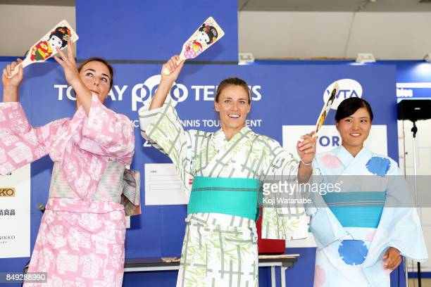 Abigail Spears and Alicja Rosolska and Makoto Ninomiya wearing Yukata plays Hagoita traditional wooden paddle game during day two of the Toray Pan...