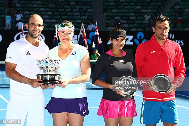 Abigail Spears and Juan Sebastian Cabal of Columbia and Sania Mirza of India and Ivan Dodig of Croatia pose with their trophies after their Mixed...